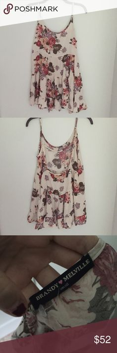 Rare floral Jada This dress is hard to find and not sold anymore. Plus it is GORGEOUS! I'm only selling it because I've grown out of it :(  It is one size but fits small best Brandy Melville Dresses