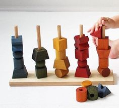 Perfect for the play pen or the desk, this divine stacking toy from Wooden Story comes in vegetable-died rainbow or natural. All treated with botanical oils and beeswax to feel and smell divine! A total luxury on the senses. Our next shipment lands November 17 just in time for Christmas! http://www.axistoys.com/Brands/WoodenStory?product_id=1235