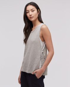 Muted grey tones and a fluid drape are two of many things that make this piece special. Made from pure linen, this knitted tank top is lightweight and breathable. The side tie detailing allows you to change your silhouette by altering the shape. Layer on top of a silk camisole with earthy tones to it for the finishing touch.