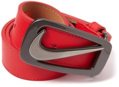 Nike signature swoosh cut out.  A hidden Nike Grip technology patch is sewn right below the buckle tab.
