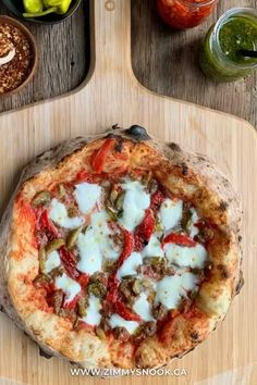 My wife asked me to recreate one of her favourite pizzeria pies. The NAPOLI DYNAMITE from @makerpizza. I used hot leek sausage, green olives, pickled jalapeños, roasted red peppers, Buffalo mozzarella, parmesan, �sea salt, & seasoned passata. We both agree it was a success and I will definitely make it again! 🔥🍕👍👍 @oonihq Buffalo Mozzarella, Pickling Jalapenos, Roasted Red Peppers, Pizza Recipes, Sea Salt, Olives, Parmesan, Vegetable Pizza, Nook