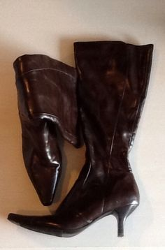 Dark brown vinyl boots size 9. Good condition, rarely used. Small heel. Zipper side.