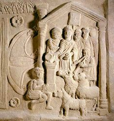 The Bridgeness Slab (from the Antonine Wall, Scotland). On the right panel is a depiction of the ritual cleansing of the legion, with with a soldier at rear carrying the vexillium, or flag of the Legio II Augusta.  n the foreground are the victims, a boar, ram and bull, with a servant and flute player. Behind them the celebrant pours a libation on the altar.   National Museums of Scotland    http://www.bridgenessslab.org.uk/index.php/roman-history-scotland/1-the-bridgeness-slab-boness