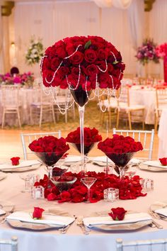 Reception flowers, the rose petals are covering the base and the draping heading is romantic. The variation in heights of the glasses is great the smaller one frame the piece. Red And White Wedding Decorations, Red And White Weddings, Reception Decorations, Decoration Table, Wedding Reception Flowers, Wedding Table, Wedding Dress, Red Rose Wedding, Black Red Wedding