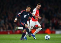 Thiago Alcantara of Bayern Munich is watched by Santi Cazorla of Arsenal during the UEFA Champions League Group F match between Arsenal FC and FC Bayern Munchen at Emirates Stadium on October 20, 2015 in London, United Kingdom. (Oct. 19, 2015 - Source: Paul Gilham/Getty Images Europe)