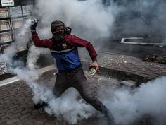 A masked Kurdish militant throws tear gas canister towards Turkish police during clashes with Turkish police on Aug. 30, 2015 in the Gazi district of Istanbul.   Ozan Kose, AFP/Getty Images