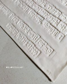 A fresh 'Words in Porcelain' just out of the kiln after its first firing. In between the first and second firing, I apply black… Handmade Art, Tiles, Art Pieces, Lyrics, Arts And Crafts, Porcelain, How To Apply, Fresh, Words
