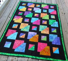 Easy Quilt pattern- downloadable pdf file for a pretty batik quilt! Introducing my latest quilt pattern design, Batiks Gone Wild! This simple pattern brings out the amazing colors of the batiks and is easy enough for a beginning quilter to tackle! A more experienced quilter can