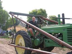 My dads 1946 John Deere model A with a farmhand loader--- He got it brand spankin new his senior year it literally changed the way farm work was done as it was mostly hand work before the farmhand ----It still runs good pL ---PUT-put-PUT-put PUT Mean Green, Old Tractors, Senior Year, Good Old, Farm Life, Drawing Reference, Farming, Dads, Antiques