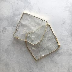 Handcrafted in India, these unique natural stone coasters feature a gold rimmed edge. Sold as a set of 2 pieces. MATERIALCrystal Quartz diameter DELIVERYPlease note that this product will be delivered to you in approximately wo South African Shop, Stone Coasters, Quartz Crystal, Natural Stones, Im Not Perfect, Shops, Crystals, Random, Furniture