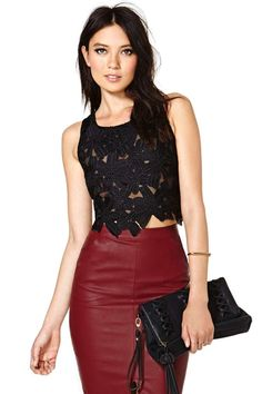 For the flower child in all of us, the Petal Pusher Top will cover you in black daisies from neck to navel.