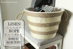 Linen Lined Rope Basket | The Wood Grain Cottage. Would you believe this started out life as a small plastic laundry basket from Dollar Tree? I think not.