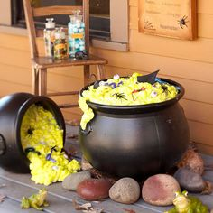 Outdoor Cauldron: Fill two plastic cauldrons with spray-foam insulation; let it dry. Then use spray paint to add a yellow-green tint to it. Accent with plastic creepy crawly creatures.