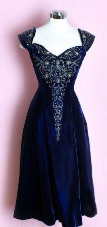 Blue velvet beaded dress.