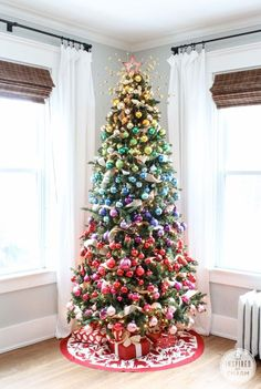 A rainbow-inspired Christmas tree! via Inspired by Charm #IBCholiday #12days72ideas