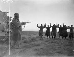 Italian soldiers surrendering to an Australian infantryman during the attack on Bardia, Libya.