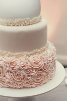 a woman loves pearls and roses and the softness of the fondant creates such an elegant presentation!