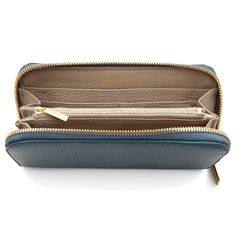 Timeless and secure, our pebbled leather wallet, with gold hardware and wraparound zipper, creates the ideal environment for some of your most treasured items. Inside, a surprise pop of color (in select hues) adds intrigue, while a full range of practical pocket slots keep your cash neat, your ID accessible and your credit cards organized. And if loose change isn't your thing, the interior zip-pocket keeps runaway coins in check.