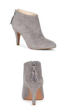 Grey suede heeled ankle booties with zipper tassels