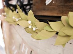 leaf Garland using painted paper lunch bags (attach some little flowers?) for podium/stage/wherever garland