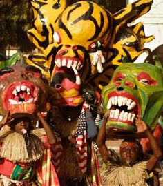 Children wear handmade masks during carnival celebrations in Guinea-Bissau