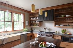 Open shelving done right! We love the range hood as a focal point in this kitchen design.