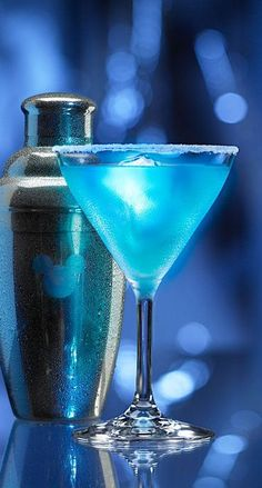 Looks like Magic! Blue Glow-tini Disney Cocktail Recipe (1 ounce Skyy Infusions Citrus Vodka ½ ounce BOLS Peach Schnapps ½ ounce BOLS Blue Curacao liqueur 1 ounce sweet-and-sour mix ½ ounce pineapple juice)