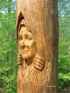 Woman carved in a tree trunk - art by Lundy Cupp