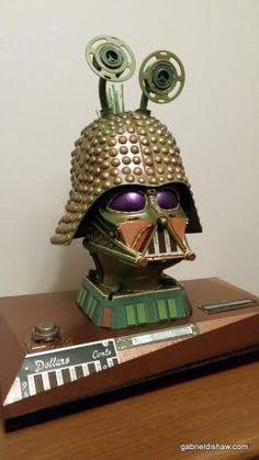 I call this one Greedo Vader see more of my creations gabrieldishaw.com #gabrieldishaw #theartliving theartproject #upcycled #upcycler #junkart #sculpture #recycled #art #recycledart #creative #greenart #artoftheday #artsnapper #artwithoutborders #artsy #artists_community #artistoftheday #scifi #starwars #starwarsart #darthvader #darth #vader #mask #carbonite #hansolo