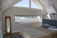 Guest room 1 panoramic landscape window with a pitched roof tongue and groove cieling #contemporaryinterior  #modern residentialarchitecture #capetownhomes #contemporarydesign