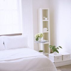 Use white accessories and storage solutions for an all-white bedroom theme.