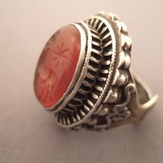 "Silver, cornelian intaglio, Afghanistan     Description      This  ring typicaly afghani is interesting  by its Afghan design but also and especially by the beauty of his finely chiseled carnelian intaglio in the likeness of a donkey...           Size:8,5 adaptable    Weight:23,2gr  www.halter-ethnic.com   see ""My Lucky Finds"""