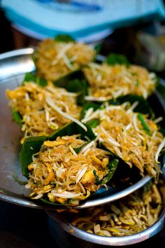 Phat Thai to go, served in banana leaf cups, Phat Tha Ratchawong, Bangkok  Chinatown open-air stall serving tiny dishes of phat Thai on Thanon Ratchawong.