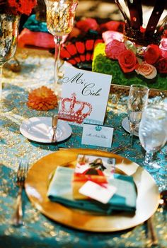 I liked the idea of having table names instead of #s. In this example they used terms of endearment. Another option would be cities in Spain. Not as prettily done, but shown here: http://karenstamps.typepad.com/.a/6a00d83452b07e69e20133f54377a7970b-pi
