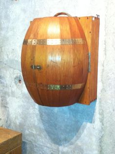 This is a wall hanging bar in the shape of a barrel made in Japan in the 1970s.  Available at d. zelen in San Francisco on Sutter Street.