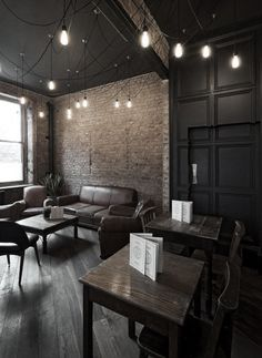 Panelling on the black wall with rustic floors and walls.  My new office inspiration