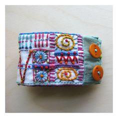 Hand Embroidered Recycled Geometric Cuff. $83.00, via Etsy. Denim Bracelet, Fabric Bracelets, Bracelet Cuir, Seed Bead Bracelets, Handmade Bracelets, Handmade Jewelry, Textile Jewelry, Fabric Jewelry, Jewelry Art