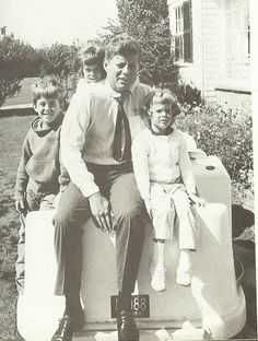 The Lawford children posing with their Uncle Jack. President Kennedy with his nephew, Christopher Lawford, and his nieces, Sydney and Victoria Lawford, outside his home in Hyannis Port.