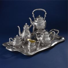 An American Silver Five-piece Tea and Coffee Set with Matching Two-handled Tray, Gorham Mfg. Co., Providence, RI, chased by Nicholas Heinzelman, 1895-98 | Lot | Sotheby's
