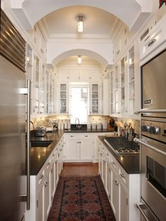 This is one of the loveliest galley style kitchen I have seen in a long time. Every aspect of it is superbly done.