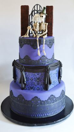 haunted mansion themed wedding cake with edible lace and haunted mansion wallpaper