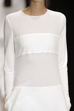 Minimal Fashion - understated white dress with round neck and horizontal band detail - subtle contrasts; elegance in simplicity