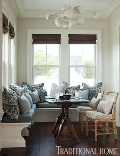 Lovely New England Summer Home with Neutral Palette | Banquette and the spaces for eating veer toward the casual but with plenty of noteworthy sculpture to contribute to the easy vibe.
