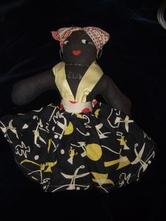 "Old Black Cuban Cloth Doll 1950s 12""    $ 18 My grandmother went to Cuba in 59 or 60 and brought me a doll just like this one."