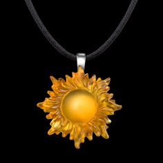Sun pendant by Matt Bezak. Cast glass, 14k white gold.