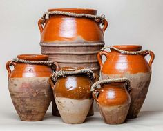 Tangia with friends | Moroccan Jewels. A tangia (sometimes spelled tanjia) is a Moroccan urn-shaped clay cooking pot. The same word also refers to the meat dish which is cooked in the tangia.