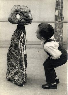 Little boy looking at a work of Joan Miró. Photo by Sabine Weiss.