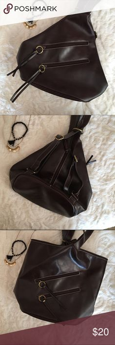 Nine West Purse NWOT convertible Nine West purse that can be a backpack or a shoulder bag. Is adjustable by the straps and has many pockets. Never used and still has gel fresheners. Nine West Bags