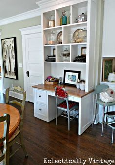 Eclectically Vintage Kitchen Desk - another green walled living room idea kitchen desks, built in desk and shelves, built in shelves office, built in desk living room, desk kitchen, built in desk ideas, cubbi, home office desk shelves, shelves with desks