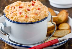 Recipe: Pimento Cheese _ A Southern staple. My roommates and I would stand blissfully around the kitchen counter slathering slices of Wonder Bread with the chunky spread, barely swallowing before attacking the next bite.